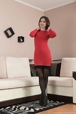 Slava Sanina takes off red dress on her couch - pic #1