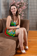 Snow strips naked while in her living room - pic #1