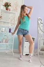 Stella strips from denim shorts to masturbate - pic #1