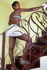 Sunita dusts the banister - pic #1