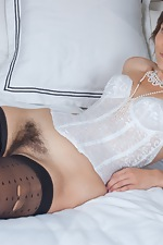 Suzette is looking sexy in her white lingerie - pic #9