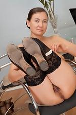 Sveta tugs on her mature bush - pic #9