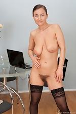 Sveta tugs on her mature bush - pic #11