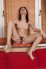 Taffy strips naked on her new red couch - pic #10