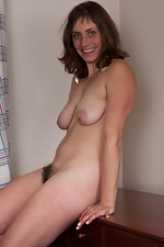 Tanya treats her hairy pussy after a long night - pic #8