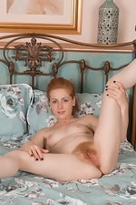Tia Jones slides off white lingerie to get in bed  - pic #16