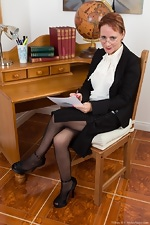 Tiffany T caresses her pussy hair in the office - pic #1