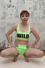 A sporty Trixie strips naked after stretching  - pic #2