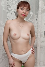 A sporty Trixie strips naked after stretching  - pic #4