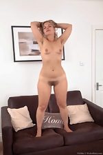 Ulrikke strips naked on her brown couch - pic #14