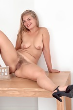 Ulrikke strips nude on her dinner table - pic #11