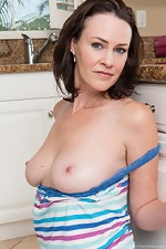 Hairy woman Veronica Snow strips in the kitchen - pic #4