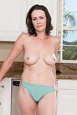 Hairy woman Veronica Snow strips in the kitchen - pic #7