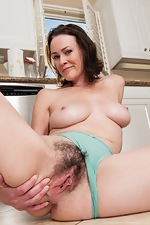 Hairy woman Veronica Snow strips in the kitchen - pic #9