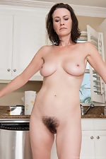 Hairy woman Veronica Snow strips in the kitchen - pic #11