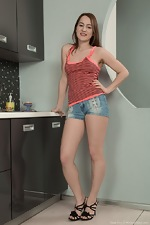 Yana Cey strips and cooks naked while showing body  - pic #1