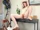 Roxanne strips naked at her grey desk