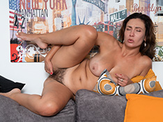 Gadget strips nude to masturbate on her sofa