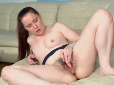 Annabelle Lee masturbates with a toy on her couch