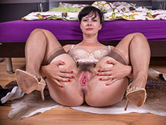 Nikita enjoys having naughty fun in her bedroom