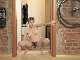 Calina strips nude and masturbates in her hallway