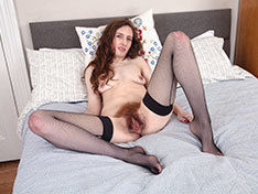 Mercy Quinn models in bed in stockings and more