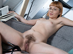 Sabrina Frash poses naked in her sexy glasses