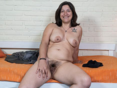 Emma strips nude in her rubber boots