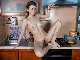 Candy Rose strips naked in her kitchen