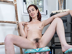 Anika strips naked by her fireplace