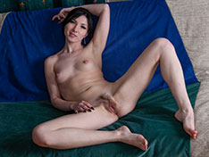 Lilianna strips naked on her colorful sofa