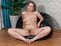 Kira Arda strips naked on her black chair
