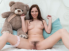 Helena R masturbates in bed with her bear