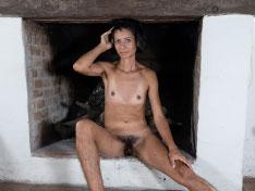 Bruna strips naked by her fireplace
