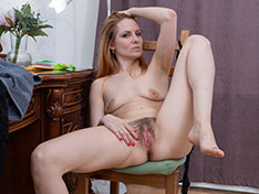 Katya strips naked on her dressing table