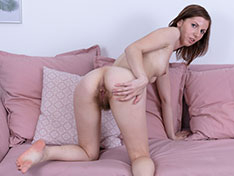 Sonia Best poses naked on her sofa