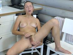 Nata masturbates to orgasms on her kitchen chair
