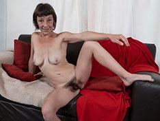 Helen H strips naked on her black sofa