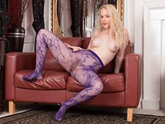 In her purple stockings, Aston Wilde strips naked