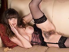 Elegant Kate Anne strips in black dress and stocking