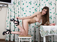 A slender and sexy Halmia strips naked