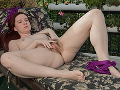 Annabelle Lee strips naked outdoors on lounger