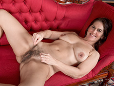 Kaysy strips off dress and lingerie on red chair