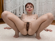A sporty Trixie strips naked after stretching