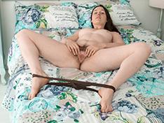 Primrose Wood strips naked in bed