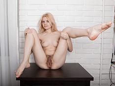 Amuza strips naked while enjoying a glass of beverage