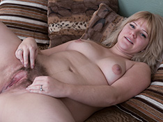 Jodie Dallas strips off grey sweater in bed