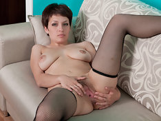 Karina leaves her stockings on exposing her pussy