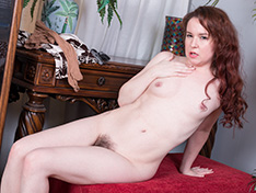 Annabelle Lee strips naked on her red bench