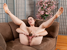Snow strips naked while in her living room